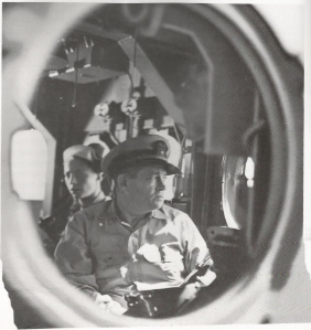 Rear Admiral Clifton Sprague thru a porthole of the 'Fanshaw Bay'