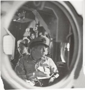 Rear Admiral Clifton Sprague thru a porthole of the 'Fanshaw Bay'