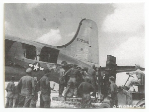 Loading an L-5 into a C-54 on Okinawa, 1945
