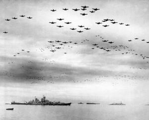 F4U's F6F's fly in formation during the ceremonies,  USS Missouri is in left foreground