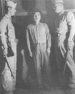 Abe Koso under guard