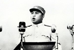 Kim Il Sung speaking at a mass rally
