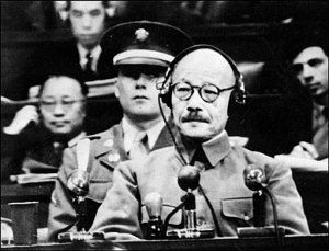 Hideki Tojo listening to interpreter during his trial