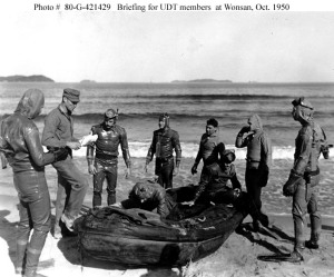 "Lt. Dan Chandler briefs his ""frogmen"" before they set out to disarm mines"