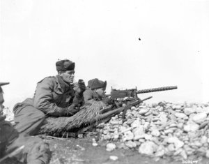 K Co., 35th RCT, 25th Div. fire at CCF w/ a M1919A4, 30 caliber air-cooler light machine gun during Operation Ripper.