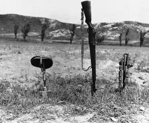 His helmet, rifle and ammunition belt mark the spot where an unidentified soldier was killed on the Korean front