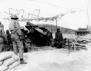 "No. 4 gun, Battery ""B"", 999th Armored Field Artillery Batt./US Army - Cpl. Andrew Williams fires gun (at right) from Doro, AL 23 Feb. 1952"