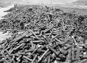G.I.s & Koreans stack the enormous pile of empty shell casings at a collection point.  This represents 4 days of fighting on the west coast.