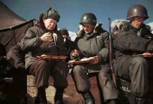 President Eisenhower having a meal with the troops