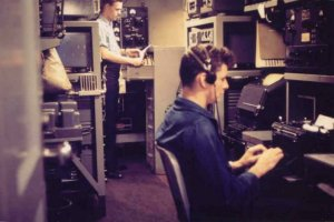 Curtis (left) in the radio shack aboard LST 1090
