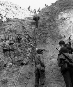 Rangers demonstrate the D-Day climb at Pointe du Hoc