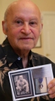 David Rogers holding his uncle's WWII picture