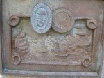badly-corroded-mystery-plaque-shows-tallship-ironclad-early-warship-aircraft-carrier-and-jets