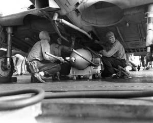 USS Enterprise crewmen load a 500 lb bomb onto a SBD scout bomber