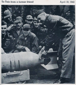 Doolittle wiring a Japanese medal to a 550-lb bomb to be used in the raid, this ceremony        was aboard the USS Hornet.