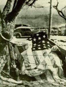 American helmet, grenade rifle & flag taken by a Japanese photographer, April 1942