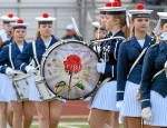 """Helsingor Pigegarde Elsinore Girls Marching Band from Denmark playing """"Anchors Away"""" while marching in an anchor formation."""