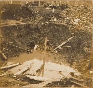 Bomb crater near Asahi Denka factory, 15' wide x 10' deep