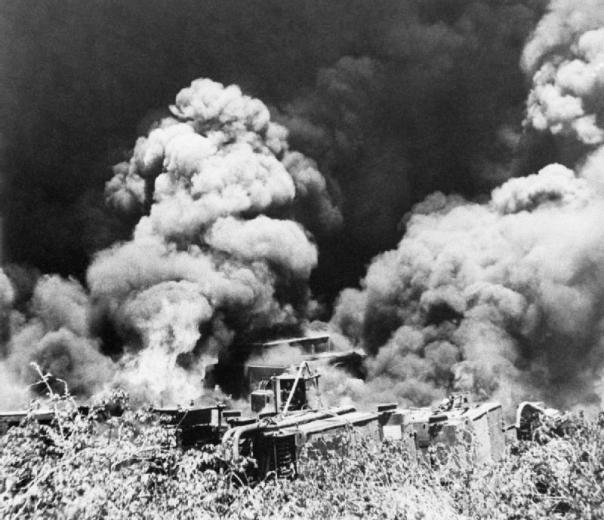 Equipment set ablaze before retreating from the Japanese, Tenangyaung, 16 April 1942