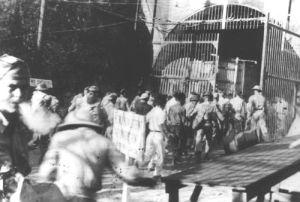 troops pour into Malinta Tunnel during air raid