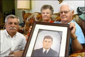 A portrait of Leland Davis surrounded by his family.