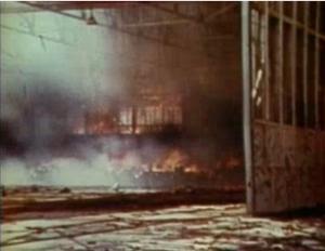 Seaplane hanger on Sand Island in flames.