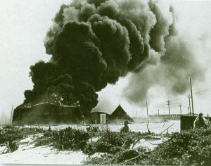 Burning oil tanks on Midway