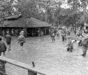 SeaBees wade through a flood on Guadalcanal