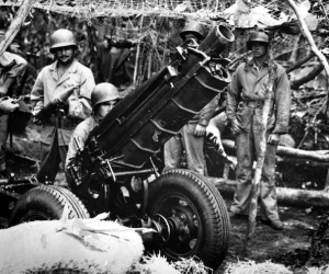 US Marines man a 75mm gun on Guadalcanal Oct. 1942