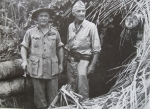Gen. Sir Thomas Blamey & LtGen. Robert Eichelberger in front of a captured enemy bunker in New Guinea
