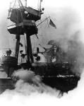 The USS Hornet while ablaze.