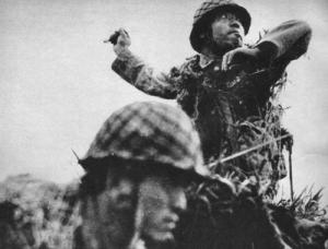 Japanese soldier throws a type 91 grenade, Guad.