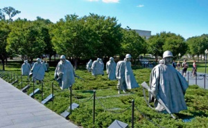 The 19 stainless steel statues were sculpted by Frank Gaylord of Barre, VT and cast by Tallix Foundries of Beacon, NY. They are approximately seven feet tall and represent an ethnic cross section of America. The advance party has 14 Army, 3 Marine, 1 Navy and 1 Air Force members. The statues stand in patches of Juniper bushes and are separated by polished granite strips, which give a semblance of order and symbolize the rice paddies of Korea. The troops wear ponchos covering their weapons and equipment. The ponchos seem to blow in the cold winds of Korea.