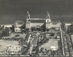 Aerial of Breakers' west facade out to County Road ca late 1940s