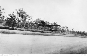 2 Spitfires take off from an airfield near Darwin.