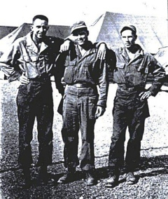 At Taegu, South Korea, Norman Deptula, left, stands with two soldiers from the 581st Signal Radio Relay Company after they had been evacuated out of North Korea. COURTESY OF NORMAN DEPTULA