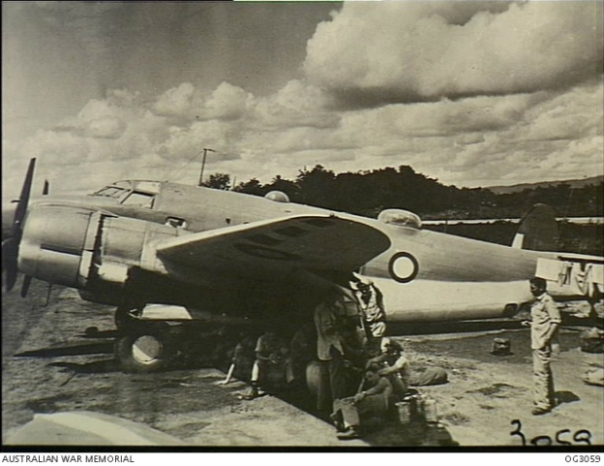 Aircrew and servicing personnel who travelled on the Lockheed Lodestar aircraft of No. 37 Squadron RAAF which escorted the Supermarine Spitfire aircraft of No. 452 Squadron RAAF during the move from Sattler airfield, near Darwin, NT, to Morotai Island in the Halmahera Islands, Dutch East Indies. They are seen here at Merauke, Dutch New Guinea, the first stop on the long flight. [AWM OG3059]