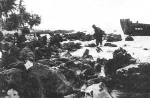 Troops on Red Beach One - a 193rd Tank Batt. light tank in background.