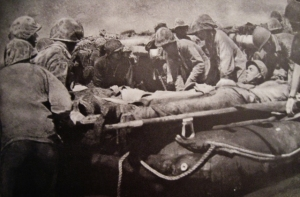 Wounded Marine sent for medical attention.