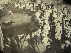 "Kneeling in prayer before landing. From: ""Tarawa - The Story of a Battle"" by Robert Sherrod"