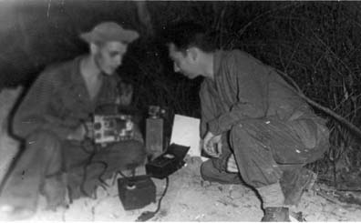 Marauder Sgt. Gerald Silvey watches Sgt. Robert Passanisi repair the 60 ib. SCR 300 FM Transceiver