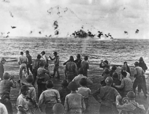 Task Force-58, carrier crews cheers as enemy aircraft goes down.