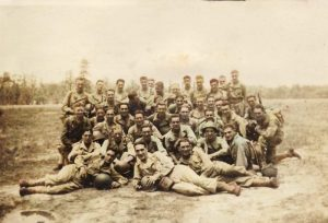 Smitty reclining in fron, on the far right, with the HQ Company/187th Regiment/11th Airborne