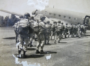 11th Airborne preparing to jump. (soldier turned around appears to be Smitty)