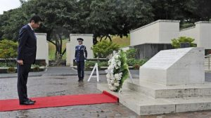 Japanese Prime Minister Shinzo Abe having a moment of silence after the laying of the wreath