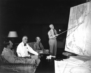 Pres. F. D. Roosevelt in conference with Gen. D. MacArthur, Adm. Chester Nimitz, Adm. W. D. Leahy, while on tour in Hawaiian Islands. 1944. (Navy) NARA FILE #: 080-G-239549