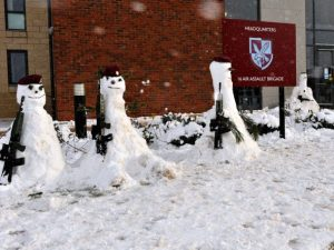 Soldiers and Officers from 16 Air Assault Brigade, build snow men during their Naafi break.