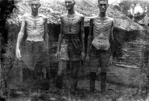 Three prisoners at Shimo Songkurai in 1943. The effects of malnutrition can be seen in their skeletal frames and the stomach of the man on the right, distended by beri beri. The photograph was one of the last to be taken by George Aspinall on the camera he smuggled up to the Thai–Burma railway from Changi. [By courtesy Tim Bowden]