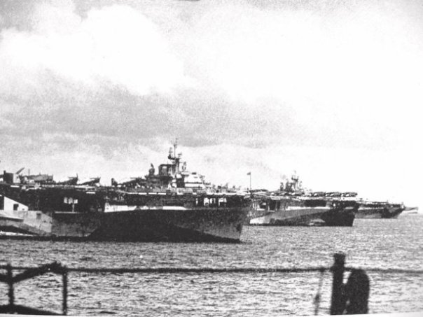"The famous ""Murderers Row"" at Ulithi lagoon, December 1944, as seen from USS Wasp (CV-18): USS Yorktown (CV-10), USS Hornet (CV-12), and USS Hancock (CV-19)."